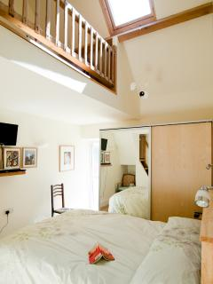 The double bedroom has a single bed in the loft