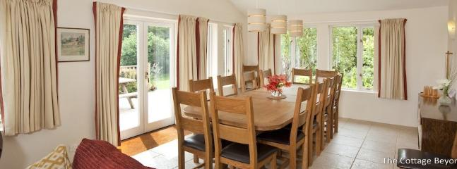 The large solid oak dinning table capable of seating 15.
