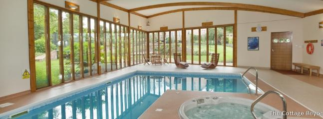 Enjoy swimming and sitting in the hot tub whilst admiring your garden