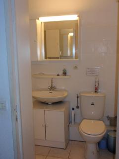 Bathroom-  view towards sink, toilet and cabinets providing a lot of storage