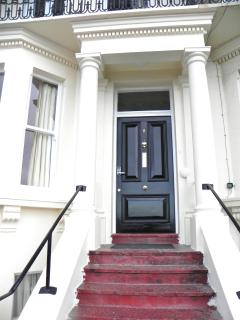 the original Victorian front door and porch