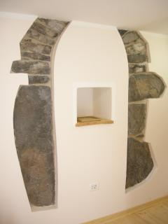The main feature of the bedroom is the stone arch believed to have been built in the 1700's.  I
