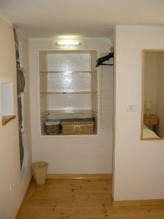 Shelves and hanging space along with 3/4 length mirror
