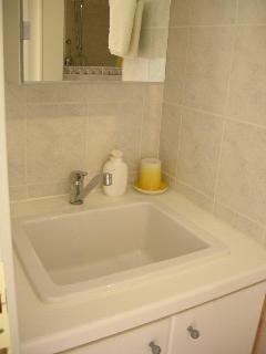 Bathroom sink and cabinets, there is also a shaving point too with over head light.