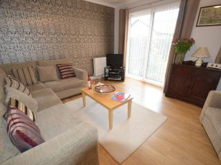 The light and airy sitting room has seating for five guests and has an LCD tv with satellite