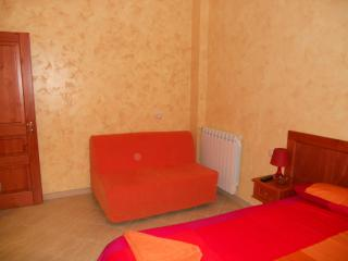 Sofa in red room for 1 adult or 2 children
