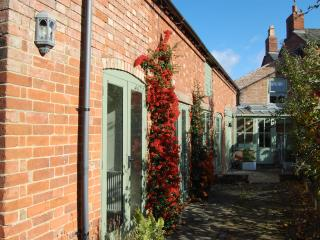 Outside entrance to Coach House Barn which overlooks beautiful espalier apple trees