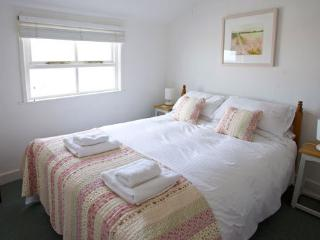 Double bedroom with view of St Nicholas Chapel and the Sea