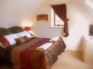 Main Bedroom, double aspect, overlooking the Brook and the garden