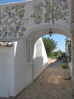 QV Archway and pathway along the back