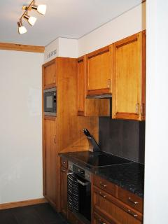 modern fully equiped kitchen with appliances and granite worktops