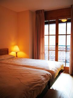 Comfortable bedroom with plenty of storeage space, balcony and ensuite bathroom