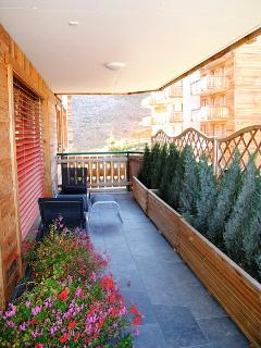 Spacious balcony with views up the piste and into village