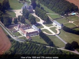 Aerial view of the estate, with 17th century buildings and 1864 chateau at the top.