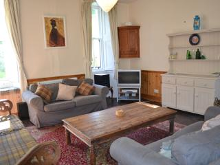A comfortable and cosy sitting room with log burning stove