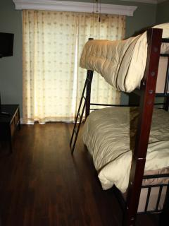 Double beds x 2 on a bunk system in one bedroom.  We love the chocolate hardwood floors.