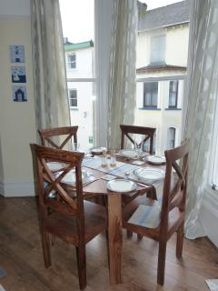 Dining table and chairs in bay window