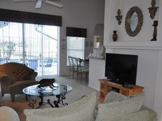 Living Room with patio doors leading to pool deck