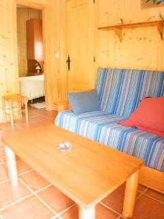Saloncito con sofá cama