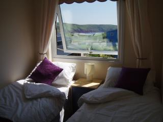 Sea view of Freshwater East Bay from twin bedroom