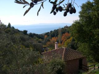 In autumn. Looking over the cottage and down the valley to the sea and the distant Island of Evia