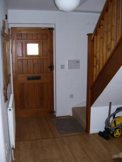 Entrance hallway and stairs to living area