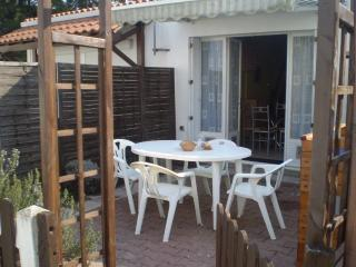 Paved patio area with ample space for eating or simply sunning yourself.