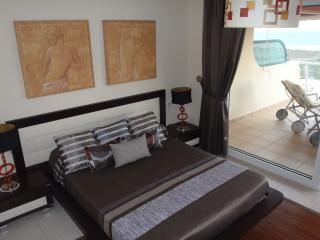Master bedroom with access to the terrace overlooking the beach