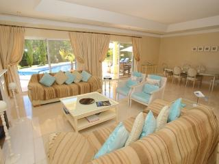 Living room with large patio doors out to covered terrace and pool area