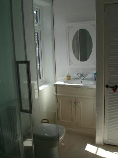 Shower room, with shower, basin and toilet. There is also a separate w/c and basin.