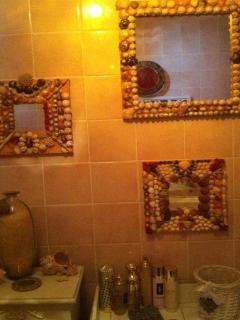 The bathroom (two wahbasins and a bath)