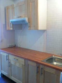 The kitchen (equipped with a cooker, a multifunction oven, a refrigerator, a washing machine))