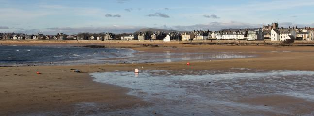 An expanse of sand exposed at low tide on Elie Beach