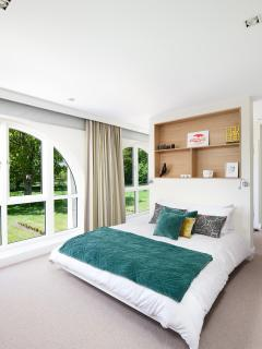 The beautifully light and spacious master bedroom