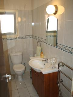 Bathroom with full size bathtub, all new fittings. Solar & Electric Water Heater.