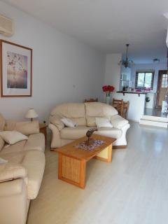 Open plan living area - large terrace leads through patio doors into lounge/dining/kitchen area