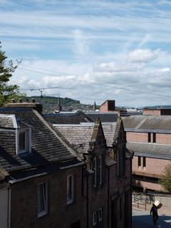 View over roof tops and church spires to Ben Wyvis
