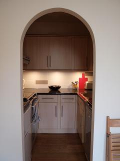 Archway to kitchenette