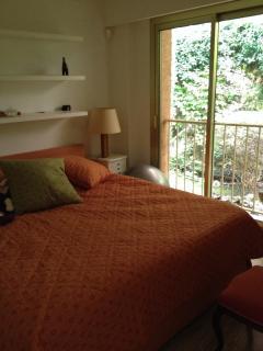 The second bedroom facing a green garden