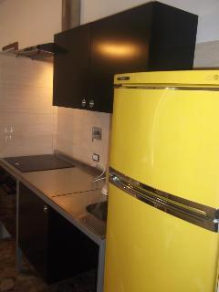 Kitchen with big fridge/freezer and oven