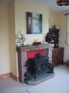 Wood burning stove with Medieval Oak beam mantlepiece