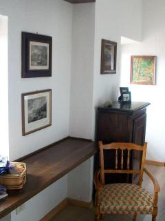A desk in the hallway on the second floor