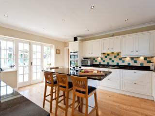 Spacious kitchen breakfast bar and seating. Double doors open into the conservatory.