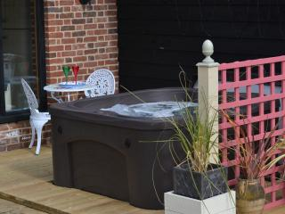 Willows Barn hot tub with waterfall feature and lights and patio seating just for two...