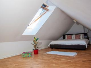 Attic Bedroom 1 with stunning view - Kingsize 1.80m American leather frame double bed & oak parquet