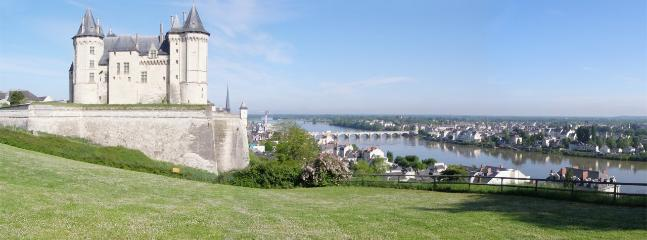 Saumur Château with the river Loire and old bridge.