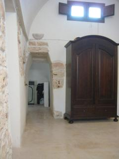 The main rom leading to the cone' room-trullo- used as storage