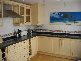 Fully fitted kitchen with granite worktop, dishwasher, washing machine, oven and microwave