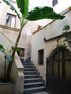 Inner courtyard with steps up to the apartment