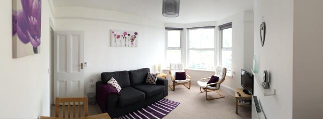 Spacious Lounge with Views of East Looe, Harbour, Estuary and out to Sea.